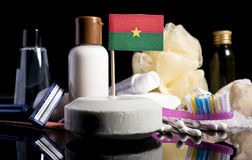 Bandera de Burkina Faso en el jabón con todos los productos para la gente Fotografía de archivo