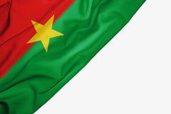 Bandera de Burkina Faso de la tela con el copyspace para su texto en el fondo blanco libre illustration