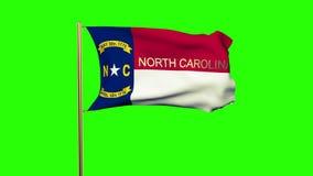 Bandera de Carolina del Norte con el título que agita en el viento libre illustration