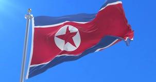 Bandera de Corea del Norte que agita en el viento con el cielo azul, lazo ilustración del vector