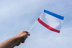 Bandera de Crimea en la mano Imagen de archivo