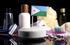 Bandera de Djibouti en el jabón con todos los productos para la gente Fotografía de archivo libre de regalías