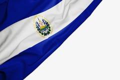 Bandera de El Salvador de la tela con el copyspace para su texto en el fondo blanco stock de ilustración