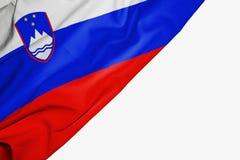 Bandera de Eslovenia de la tela con el copyspace para su texto en el fondo blanco ilustración del vector