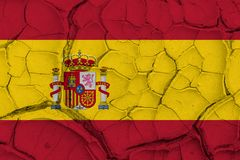 Bandera de España en fondo agrietado de la textura Foto de archivo