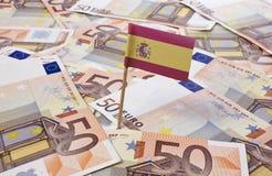 Bandera de España que se pega en 50 billetes de banco euro (serie) Fotografía de archivo libre de regalías