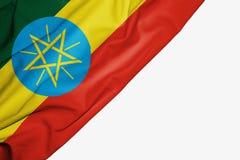 Bandera de Etiop?a de la tela con el copyspace para su texto en el fondo blanco ilustración del vector
