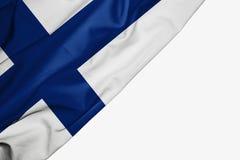Bandera de Finlandia de la tela con el copyspace para su texto en el fondo blanco ilustración del vector