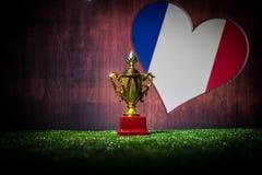 Bandera de Francia, campeón de oro \ 'taza de s en hierba Deporte del concepto Fotografía de archivo