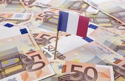 Bandera de Francia que se pega en 50 billetes de banco euro (serie) Imagen de archivo libre de regalías