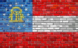 Bandera de Georgia en una pared de ladrillo Imagenes de archivo