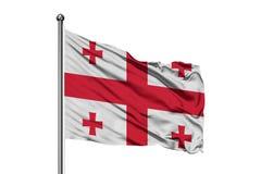 Bandera de Georgia que agita en el viento, fondo blanco aislado Indicador georgiano imagen de archivo libre de regalías