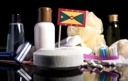 Bandera de Grenada en el jabón con todos los productos para la gente Imagen de archivo libre de regalías