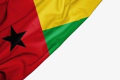 Bandera de Guinea-Bissau de la tela con el copyspace para su texto en el fondo blanco libre illustration