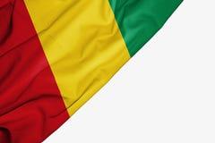Bandera de Guinea de la tela con el copyspace para su texto en el fondo blanco ilustración del vector
