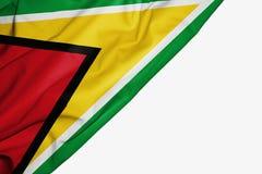 Bandera de Guyana de la tela con el copyspace para su texto en el fondo blanco ilustración del vector