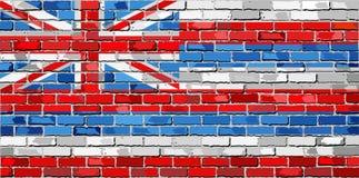Bandera de Hawaii en una pared de ladrillo Imágenes de archivo libres de regalías