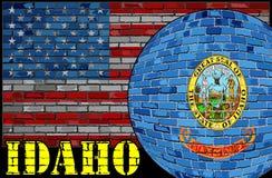 Bandera de Idaho en el fondo de la bandera de los E.E.U.U. Imágenes de archivo libres de regalías