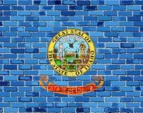 Bandera de Idaho en una pared de ladrillo Fotografía de archivo libre de regalías
