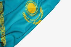Bandera de Kazajist?n de la tela con el copyspace para su texto en el fondo blanco ilustración del vector