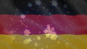 Bandera de la Alemania y de los copos de nieve almacen de metraje de vídeo