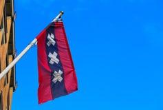 Bandera de la ejecución de Amsterdam de un edificio Fotos de archivo libres de regalías