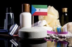 Bandera de la Guinea Ecuatorial en el jabón con todos los productos para la gente Imagenes de archivo
