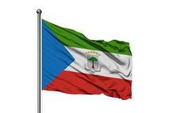 Bandera de la Guinea Ecuatorial que agita en el viento, fondo blanco aislado foto de archivo