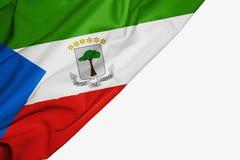 Bandera de la Guinea Ecuatorial de la tela con el copyspace para su texto en el fondo blanco stock de ilustración