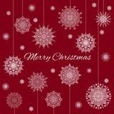 Bandera de la Navidad con los copos de nieve y el texto ornamentales hermosos en el fondo rojo Fotografía de archivo libre de regalías