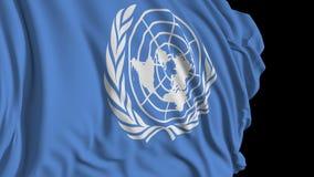 Bandera de la O.N.U en la cámara lenta La bandera se convierte suavemente en el viento stock de ilustración