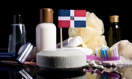 Bandera de la República Dominicana en el jabón con todos los productos para la gente Fotos de archivo