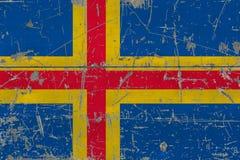 Bandera de las islas de Aland del Grunge en vieja superficie de madera rasguñada Fondo nacional del vintage imágenes de archivo libres de regalías