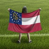 Bandera de las mujeres y de Georgia imagen de archivo