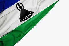 Bandera de Lesotho de la tela con el copyspace para su texto en el fondo blanco ilustración del vector