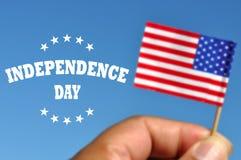 Bandera de los E.E.U.U. del Día de la Independencia con la bandera americana Imágenes de archivo libres de regalías
