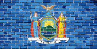 Bandera de Nueva York en una pared de ladrillo Fotografía de archivo libre de regalías
