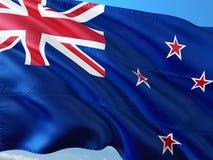 Bandera de Nueva Zelanda que agita en el viento contra el cielo azul profundo Tela de alta calidad foto de archivo