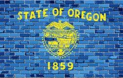 Bandera de Oregon en una pared de ladrillo Foto de archivo libre de regalías
