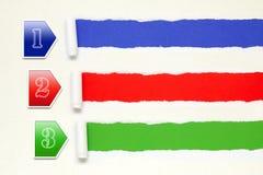 Bandera de papel con tres pasos de progresión Foto de archivo libre de regalías
