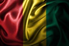 Bandera de seda del satén de Guinea ilustración del vector