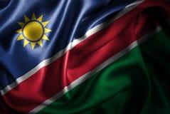 Bandera de seda del satén de Namibia ilustración del vector