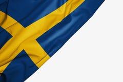 Bandera de Suecia de la tela con el copyspace para su texto en el fondo blanco libre illustration