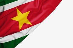 Bandera de Suriname de la tela con el copyspace para su texto en el fondo blanco ilustración del vector