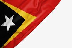 Bandera de Timor Oriental de la tela con el copyspace para su texto en el fondo blanco libre illustration