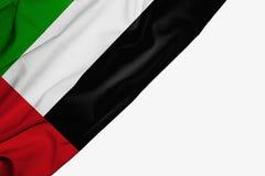 Bandera de United Arab Emirates de la tela con el copyspace para su texto en el fondo blanco ilustración del vector