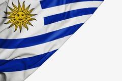 Bandera de Uruguay de la tela con el copyspace para su texto en el fondo blanco ilustración del vector