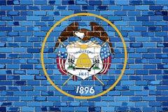Bandera de Utah en una pared de ladrillo Fotos de archivo libres de regalías