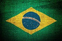 Bandera del Brasil en textura del saco del café Fotografía de archivo libre de regalías