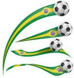 Bandera del Brasil fijada con el balón de fútbol Imágenes de archivo libres de regalías
